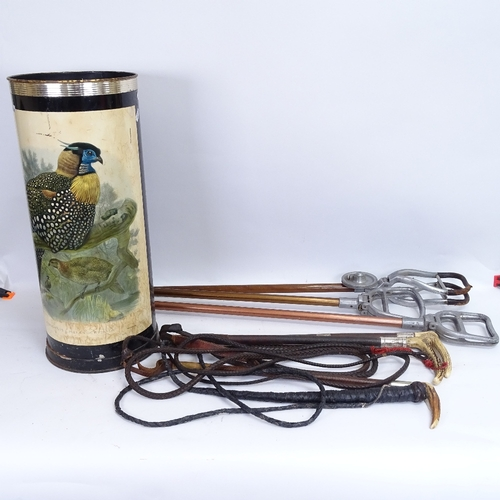 32 - A modern painted and lithographed barrel stick stand, containing 3 horn-handled riding crops and 3 s...