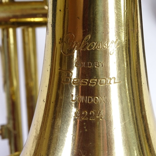 33 - An Embassy by Besson gold lacquered 3-valve trombone, serial no. 4224, length 109cm, with leather ca...