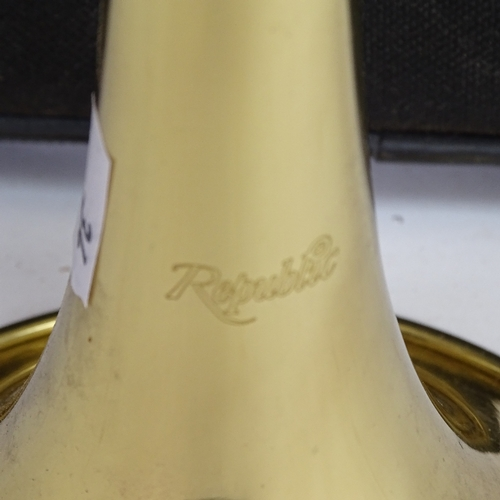 34 - A Republic gold lacquered 3-valve trumpet, length 54cm, in original fitted carrying case...
