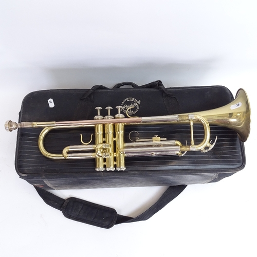 36 - A Windcraft WTR-110 gold lacquered 3-valve trumpet, serial no. 502468, in original carrying case, RR...