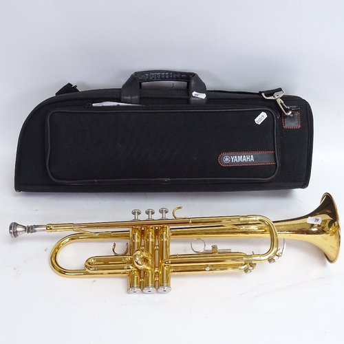 39 - A Yamaha YTR2330 gold lacquered 3-valve trumpet, serial no. U80647, length 54cm, in original Yamaha ...