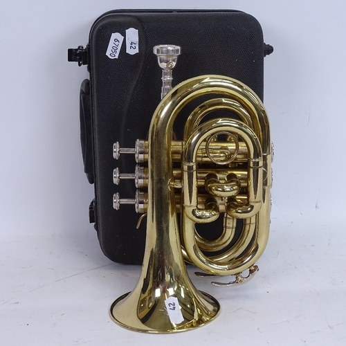 42 - A Stagg 77-MT gold lacquered 3-valve pocket trumpet, serial no. 3419, length 24cm, in original Stagg...