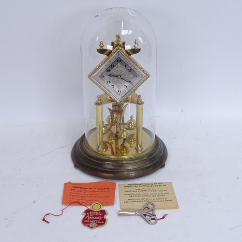 45 - A Kundo brass 400-day clock under glass dome, with original instructions, label and key, overall hei...