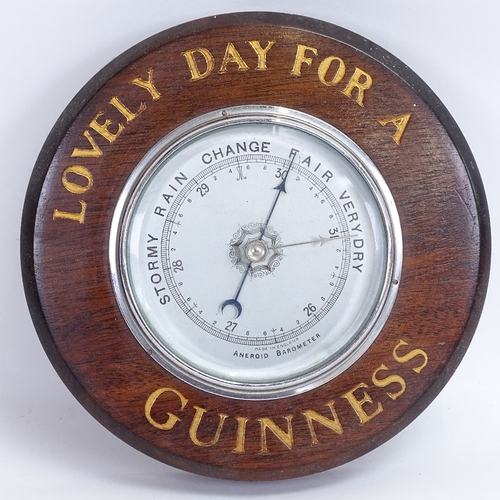 5 - A Vintage Guinness wall hanging mahogany advertising aneroid barometer, diameter 21cm...