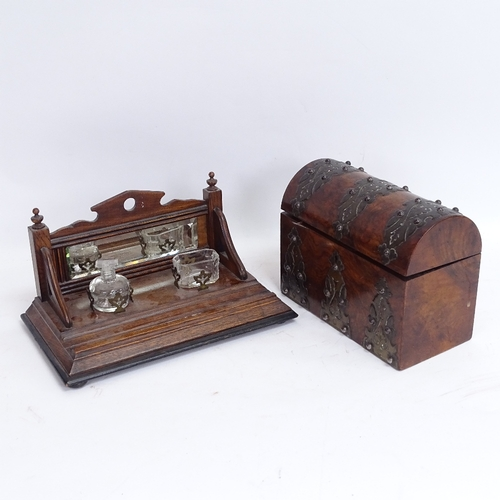 52 - A Victorian brass-mounted walnut dome-top desk box, and an oak mirror-back desk stand, box length 23...