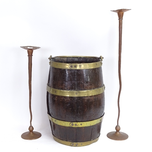 54 - A brass-bound barrel-shaped bucket, and a graduated pair of Arts and Crafts style candlesticks (3)...
