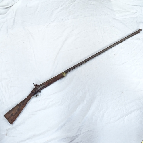 7 - A 19th century percussion musket rifle, brass strapwork and ram rod, with indistinct engraved inscri...