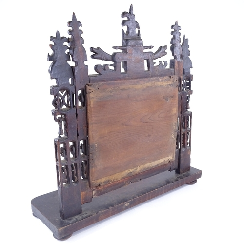 10 - A rare 18th century Welsh Folk Art carved and pierced wood-framed toilet mirror, with dragon decorat...