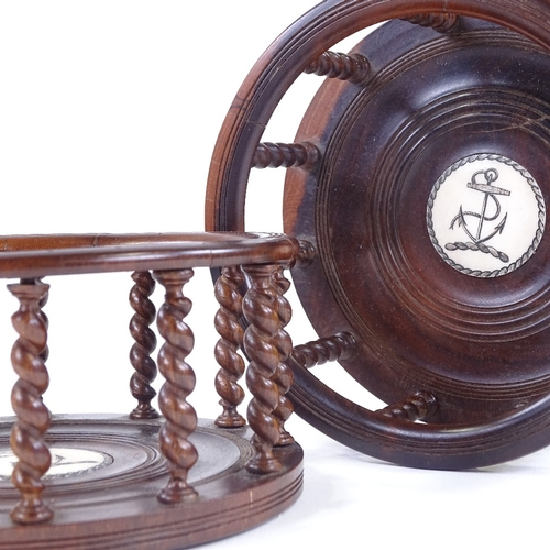 12 - A pair of lignum vitae ship's decanter coasters, with delicate barley twist spindles and inset engra...