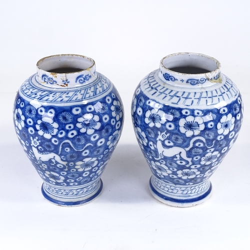 125 - A pair of Continental blue and white tin glaze pottery vases, late 18th/early 19th century, height 2...
