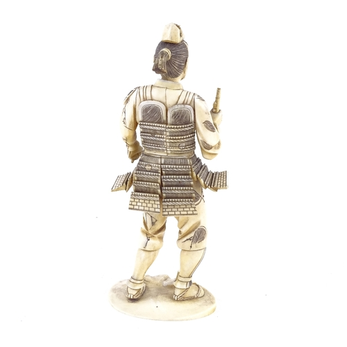 13 - A Japanese ivory carving of a Samurai Warrior, Meiji Period, signed with lacquer seal under base, he...