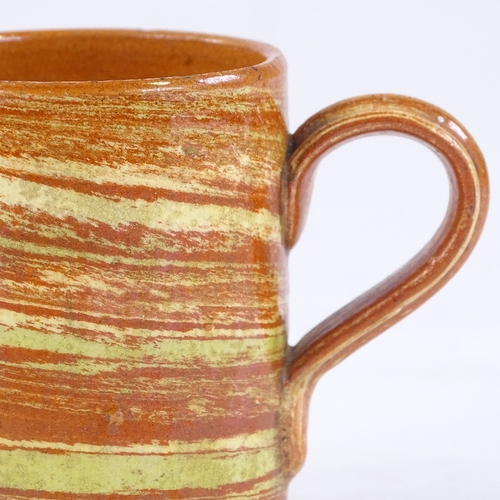 130 - A 19th century Agateware terracotta coffee can or child's mug, height 6.5cm, (BBC Antiques Road Trip...