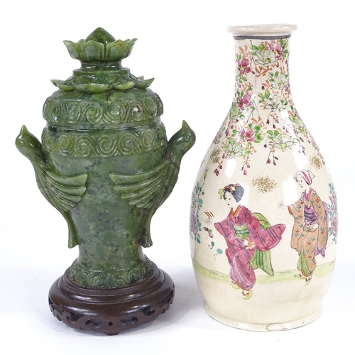 136 - A Chinese carved green stone vase and cover, on hardwood stand, height 24cm, and a Chinese bottle va...