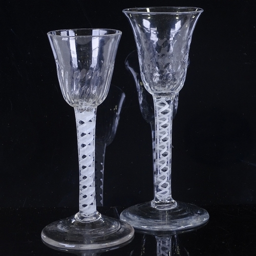 147 - 2 18th century cordial glasses with milk twist stems, height 16cm and 15cm...