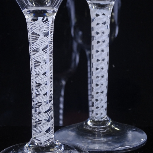 148 - 2 18th century cordial glasses with milk twist stems, height 15cm (2)...