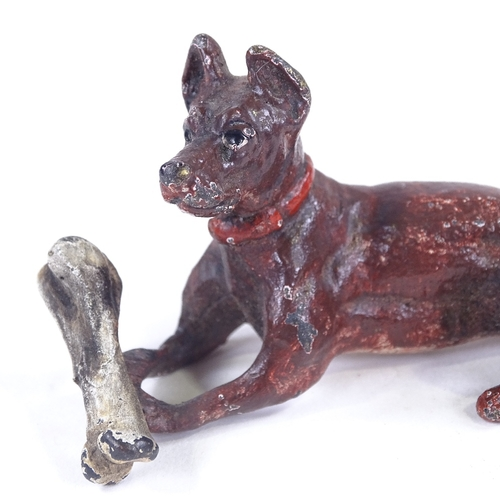154 - An Austrian cold painted bronze dog with a bone, length 6.5cm...