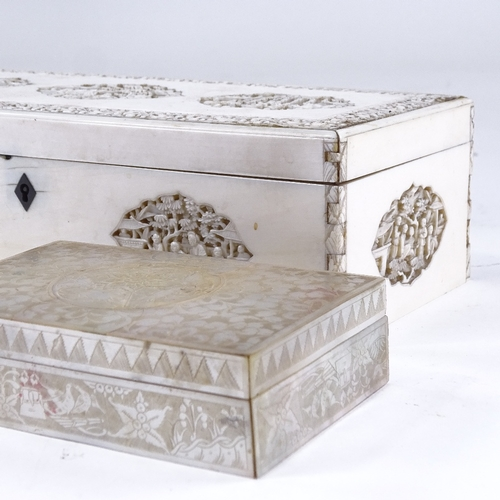 164 - A Chinese 19th century ivory box, with relief carved and pierced decoration, length 25cm, and a smal...