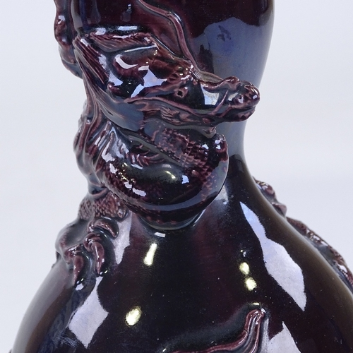 165 - A Chinese dark purple glaze double gourd vase, with entwined dragon, height 24cm...