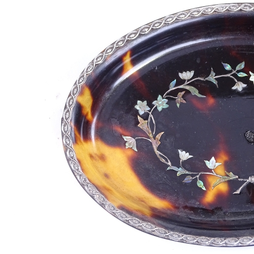 189 - A 19th century oval tortoiseshell dish, with inlaid mother-of-pearl and silver floral marquetry, 12c...