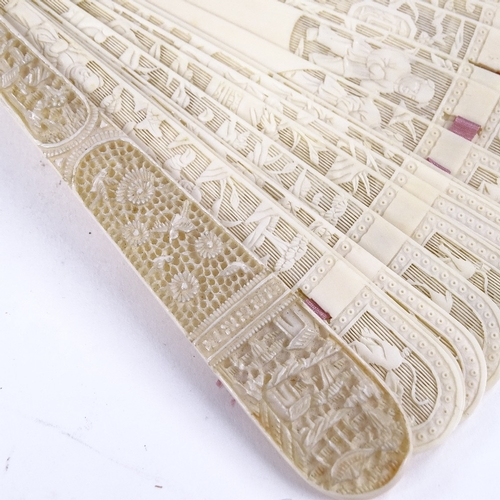 197 - A 19th century Chinese ivory brise fan, finely pierced and relief carved screen, length 19cm...