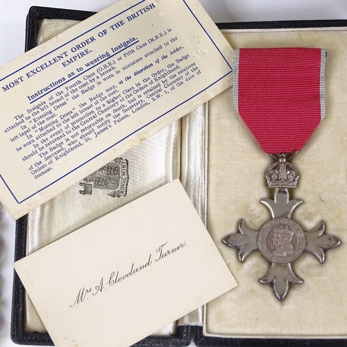 20 - A mixed group of items, including an MBE medal in original case, gold plated Dupont pocket lighter, ...
