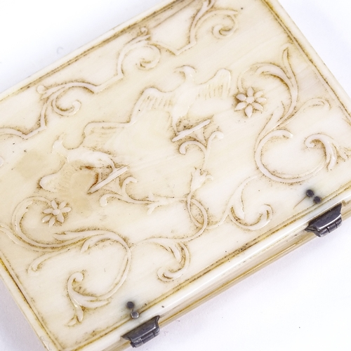 201 - A small 19th century French ivory box, with relief carved phoenix decorated lid, 7cm x 5cm...