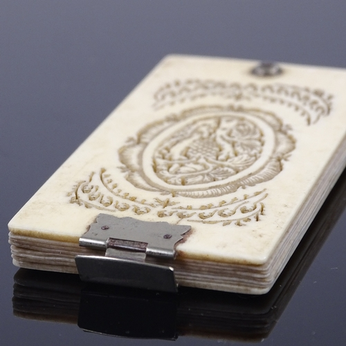 205 - A 19th century ivory aide memoire, with carved and pierced covers, and nickel plate mounts, 8cm x 4c...