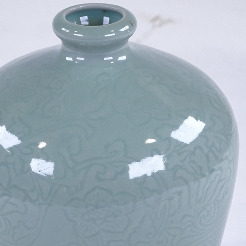 212 - A Chinese celadon glaze bottle vase with incised decoration, height 22cm...