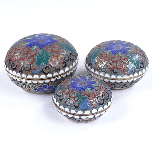216 - A set of 3 graduated Chinese cloisonne enamel circular boxes, largest 6cm across...