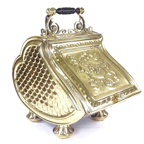 224 - A Victorian embossed brass coal bin, with floral relief decorated hinged lid and shovel...