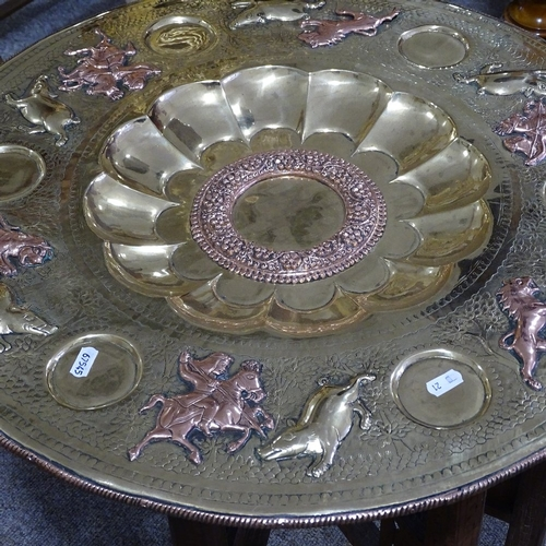 225 - An Islamic copper and brass tray on folding stand, diameter 60cm, and an Islamic brass ewer and gobl...