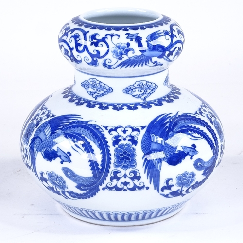 234 - A Chinese blue and white porcelain vase, with phoenix design, height 21cm...