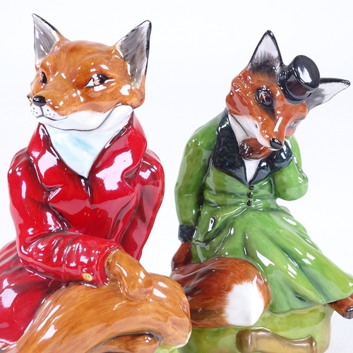 24 - A pair of Royale Stratford China, hunting fox figures, height 17cm...