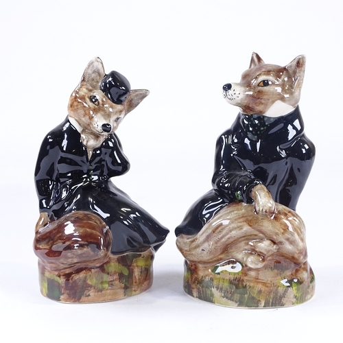25 - A pair of Staffordshire China hunting foxes in black coats, height 19cm...