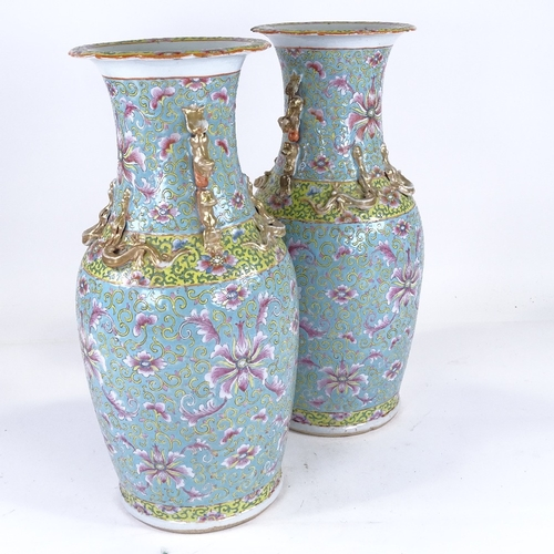 256 - A pair of Chinese porcelain vases, with painted enamel decoration and gilded dragon necks, height 47...