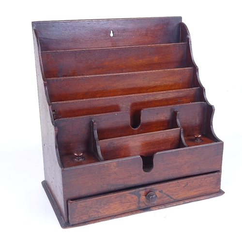 260 - A Victorian mahogany desk-top stationery rack, with drawer below, width 28cm...