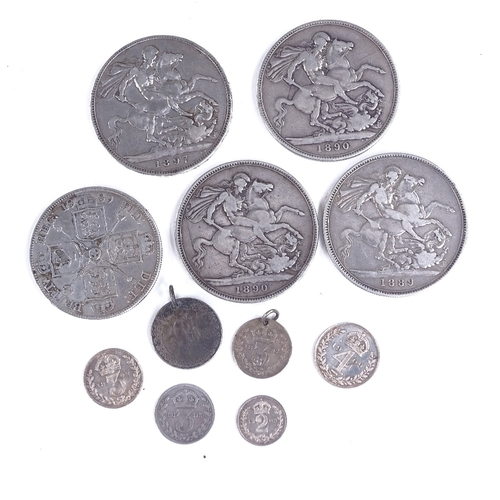 262 - A group of Victorian silver crowns and other coins...