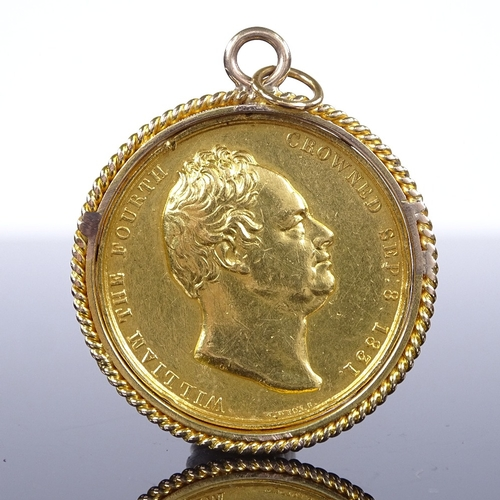263 - A 22ct gold King William IV and Queen Adelaide Coronation medallion, designed by William Wyon, in un...