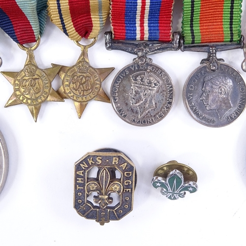 265 - A group of 4 Second War miniature medals, a 39-45 Defence medal, and a 1939-45 medal, and 2 Scouting...