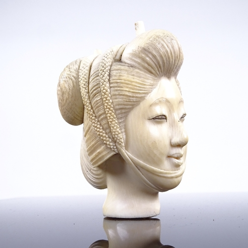267 - A Japanese ivory carving, head of a woman, Meiji Period circa 1900, height 7cm...