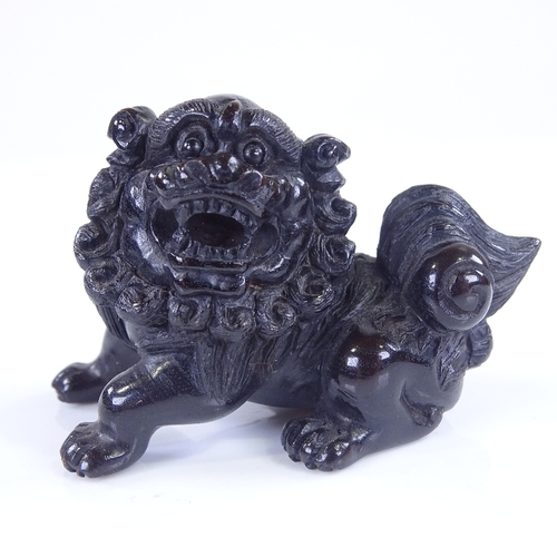 268 - A Japanese carved and stained wood Dog of Fo design netsuke, signed, length 6cm...