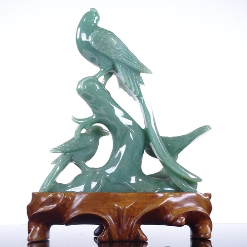281 - A Chinese jadeite carving, depicting 3 exotic birds, on hardwood stand, height 20cm...
