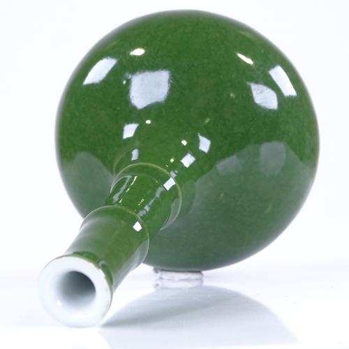 284 - A Chinese green glaze porcelain narrow-necked vase...