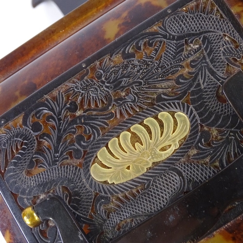 29 - A Chinese early 20th century tortoiseshell cantilever 3-section jewel box, with dragon carved and pi...