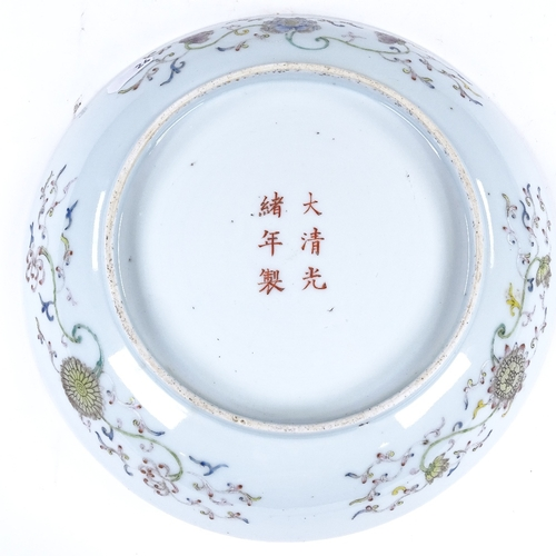 292 - A Chinese porcelain bowl with painted polychrome dragon designs, 6 character mark, diameter 24cm...