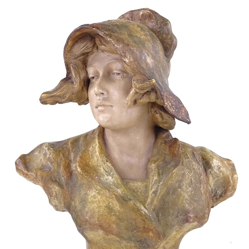 298 - GOLDSCHEIDER - painted pottery bust of a woman wearing a bonnet, signed Xarinoff, height 35cm...