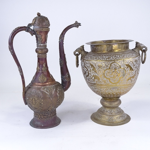 309 - An Indian engraved brass 2-handled pot, height 32cm, and a Continental copper and brass ewer (2)...