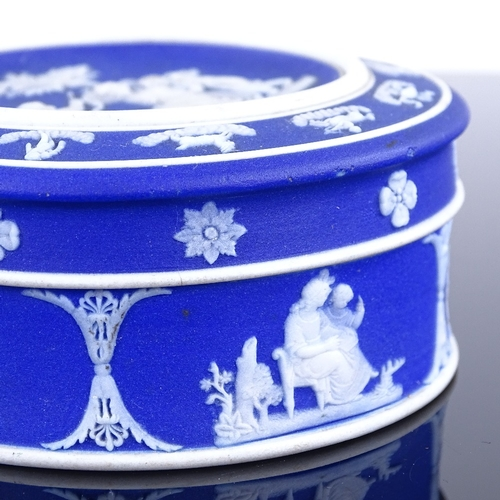 313 - A Wedgwood blue Jasper circular pot and cover, diameter 8.5cm...