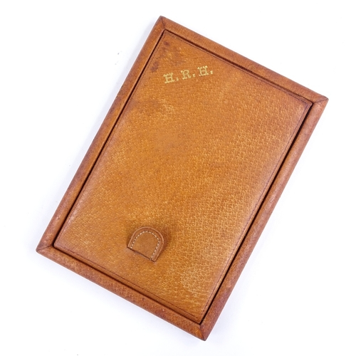 318 - A leather-covered travelling mirror, monogrammed HRH, length 17cm...