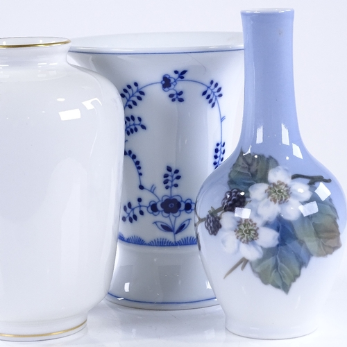 319 - A Royal Copenhagen Blackberry design vase, height 14cm, a KPM white glaze vase, and 1 other (3)...